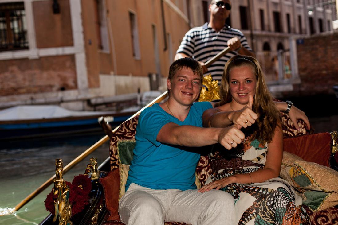 photographer on a gondola trip in Venice