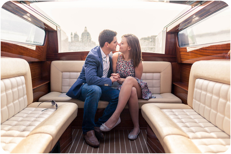 couple hug on water taxi during surprise engagement photo session in Venice