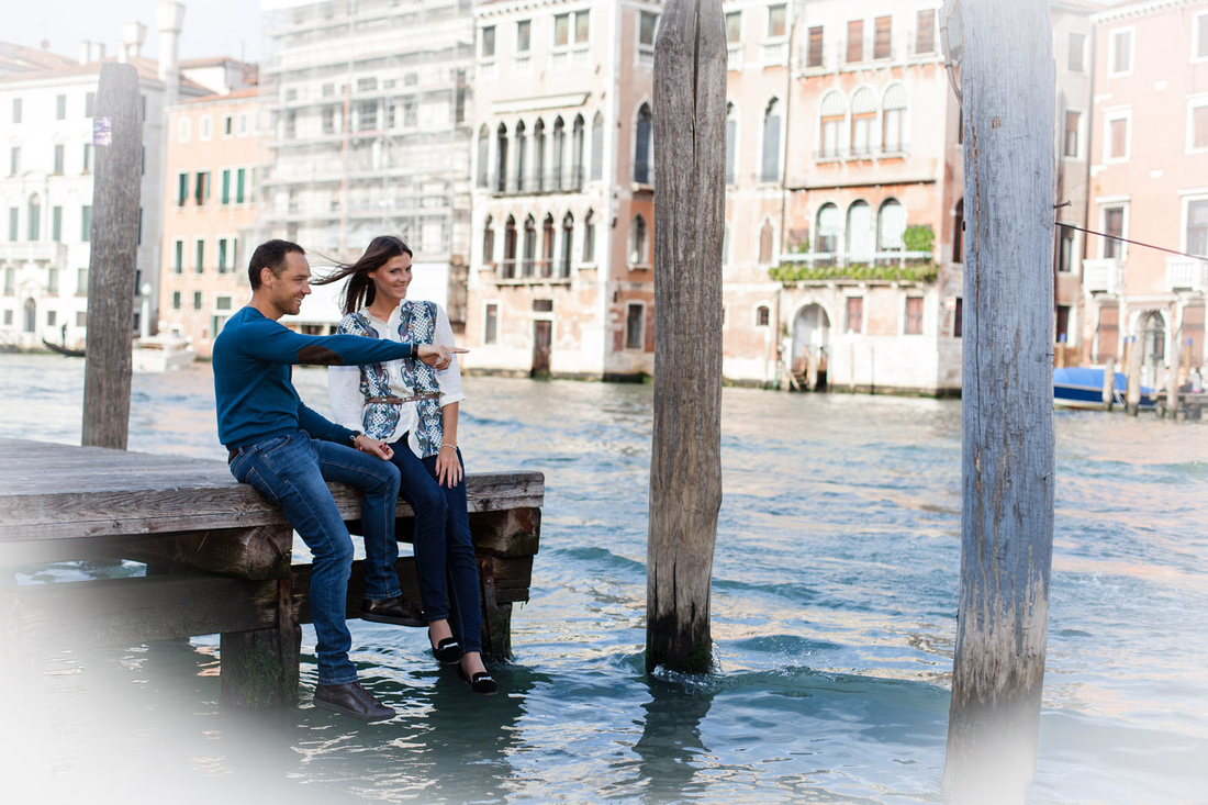 couple sitting near Canal Grande