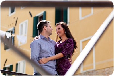 Russian couple hugging on a bridge during honeymoon photo session in Venice