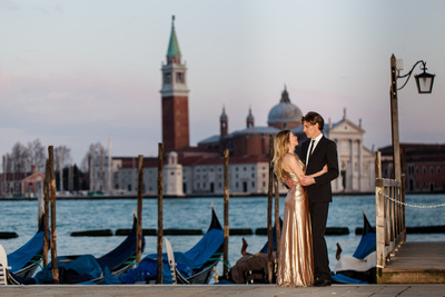Canadian couple hugging in front on the Venetian lagoon during a honeymoon photo shooting