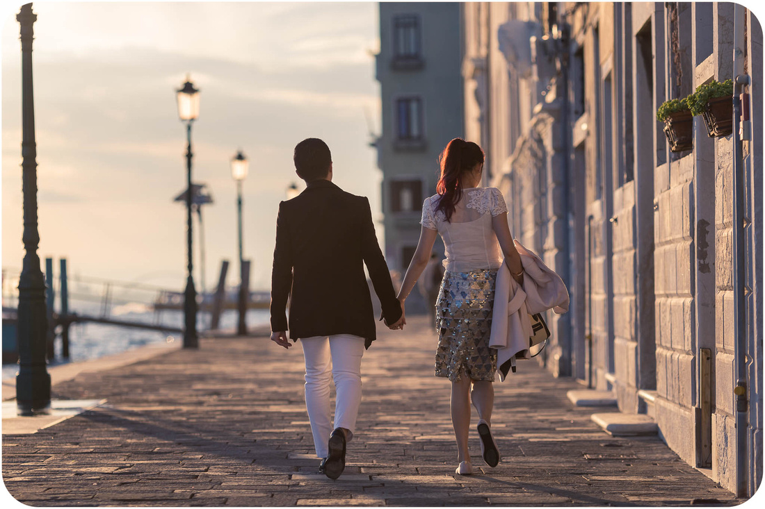 couple walking during surprise proposal photo session in Venice