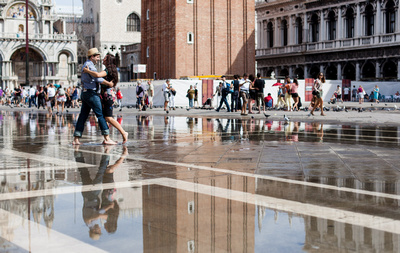 young Russian couple dancing in high water during their couple photo portrait in Venice