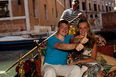 young couple portrait on a gondola in Venice
