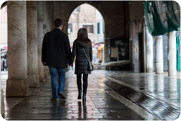 couple walking in Rialto market during couple photo portrait in Venice
