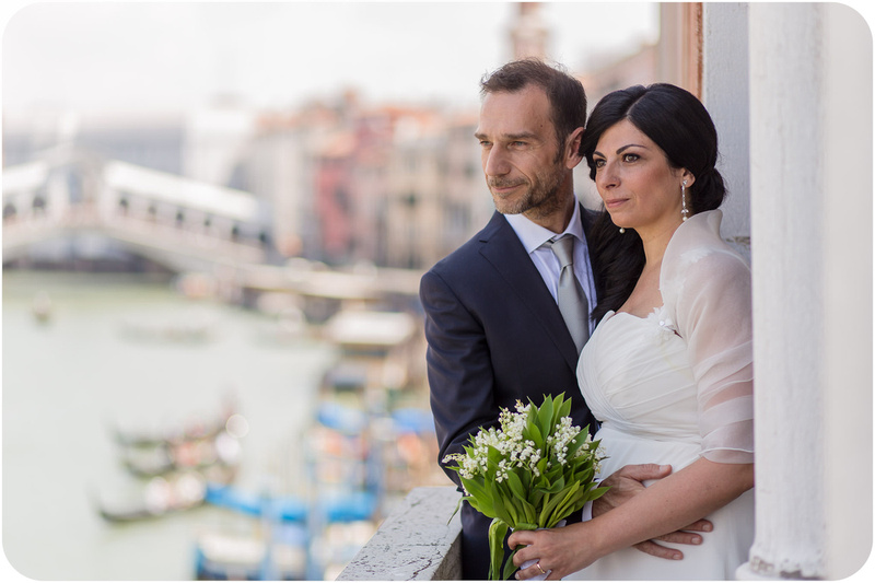 bride and groom hug during civil wedding photo service in Venice
