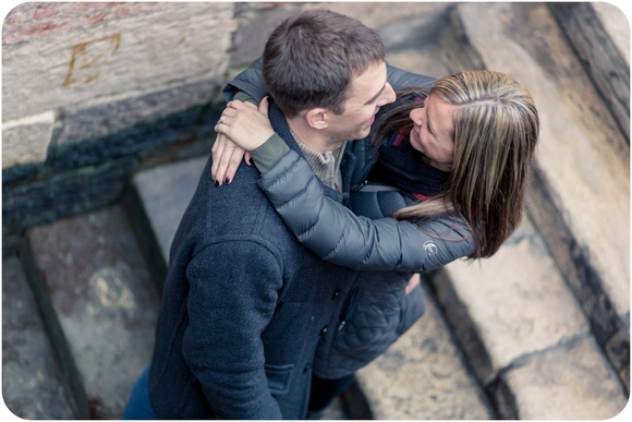 couple hugging shot from above during engagement session in Venice