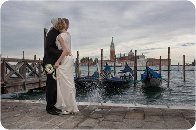 couple hugging near Piazza San Marco during wedding photo reportage in Venice
