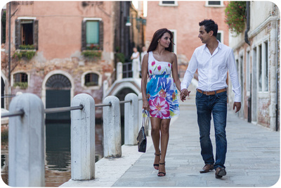 couple walking during a engagement photo service in Venice