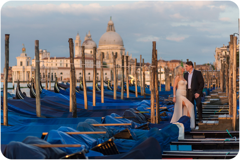 couple kissing during couple photo session in Venice at sunrise