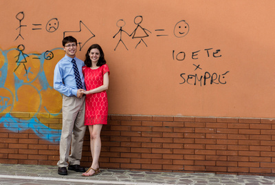 American couple hugging with graffiti wall for couple photo session in Venice