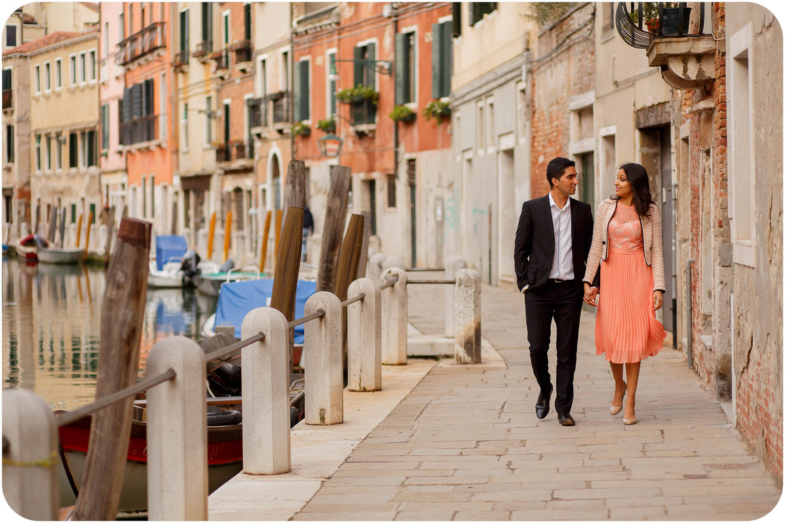 couple walking during wedding proposal photo service in Venice