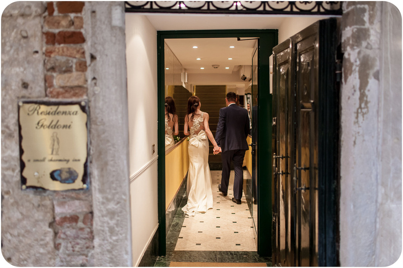 bride and groom at hotel during wedding photo session in Venice