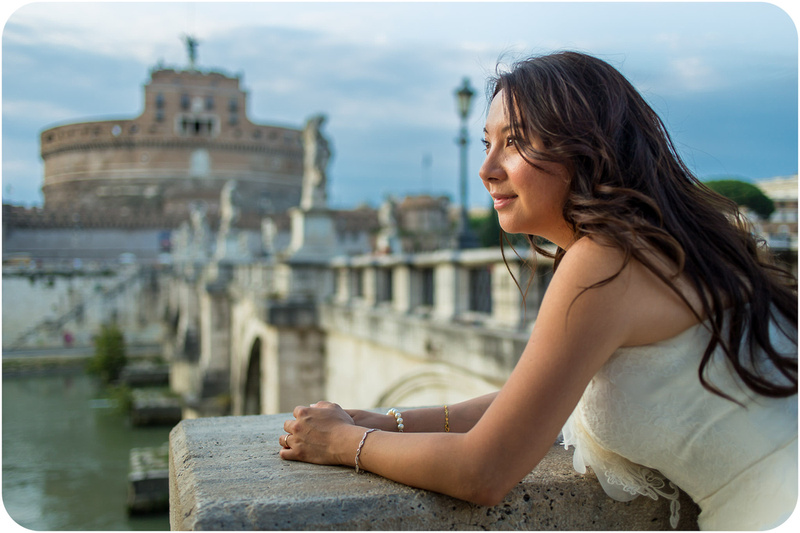 bride enjoys view from bridge during honeymoon photo session in Rome
