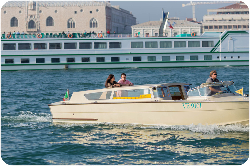 couple on watertaxi during surprise engagement photo session in Venice