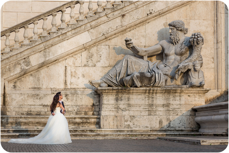 couple walk near ancient statue during honeymoom portrait in Rome