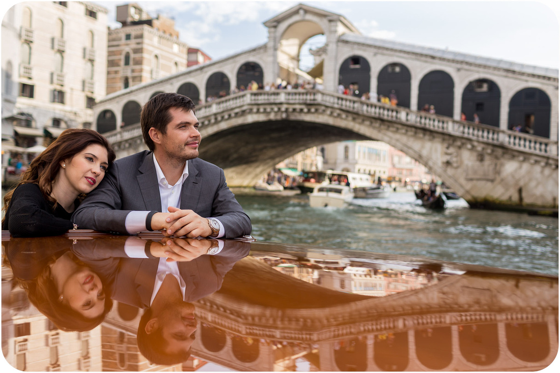 couple in water taxi during couple photo session in Venice