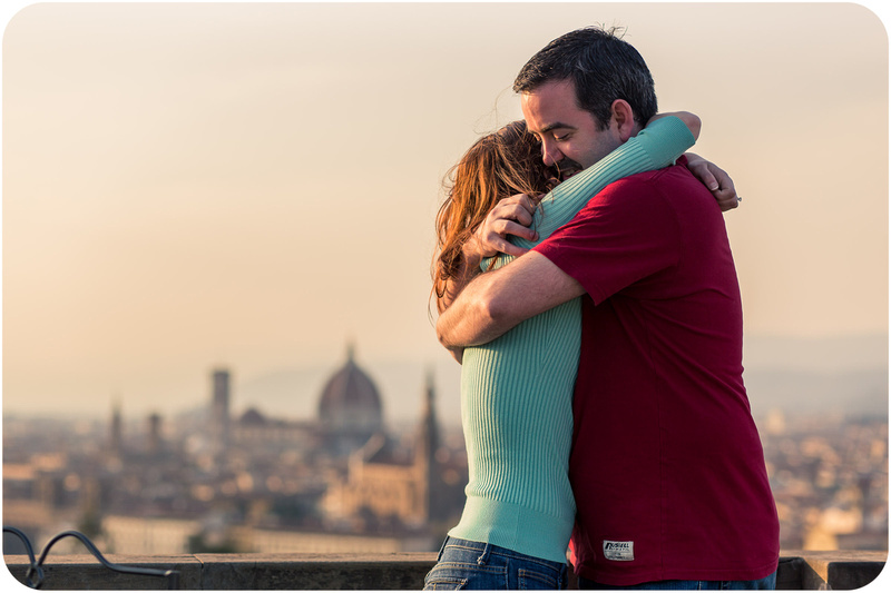 couple hugging during engagement photo service in Florence