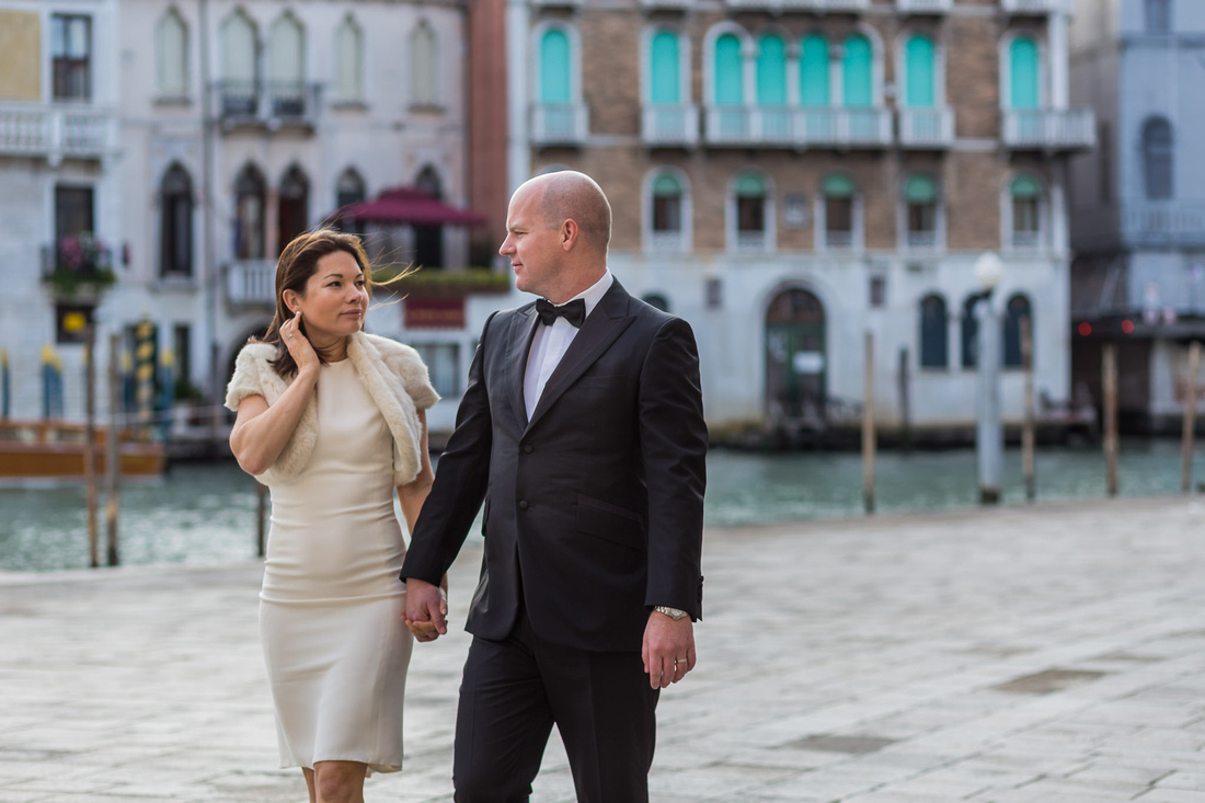 couple walking during anniversary photo session in Venice