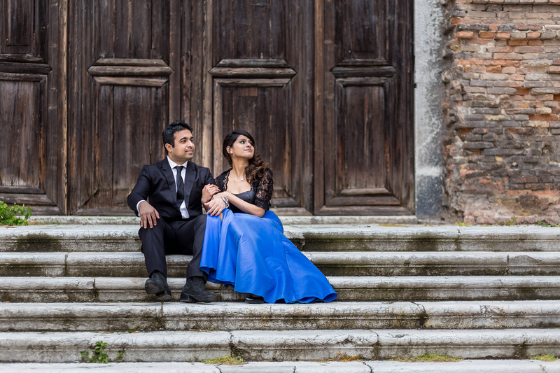 couple resting on church stairs during hoenymoon photo session in Venice