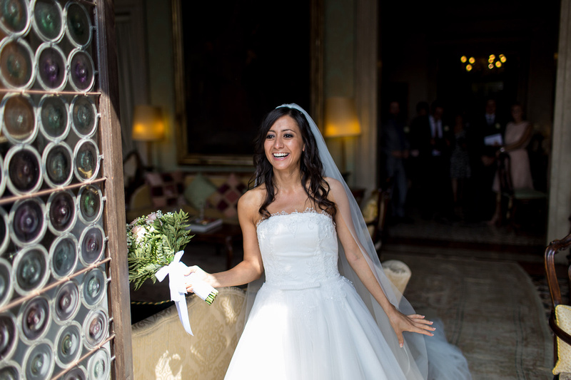 bride smiling in Church during wedding photo session in Venice