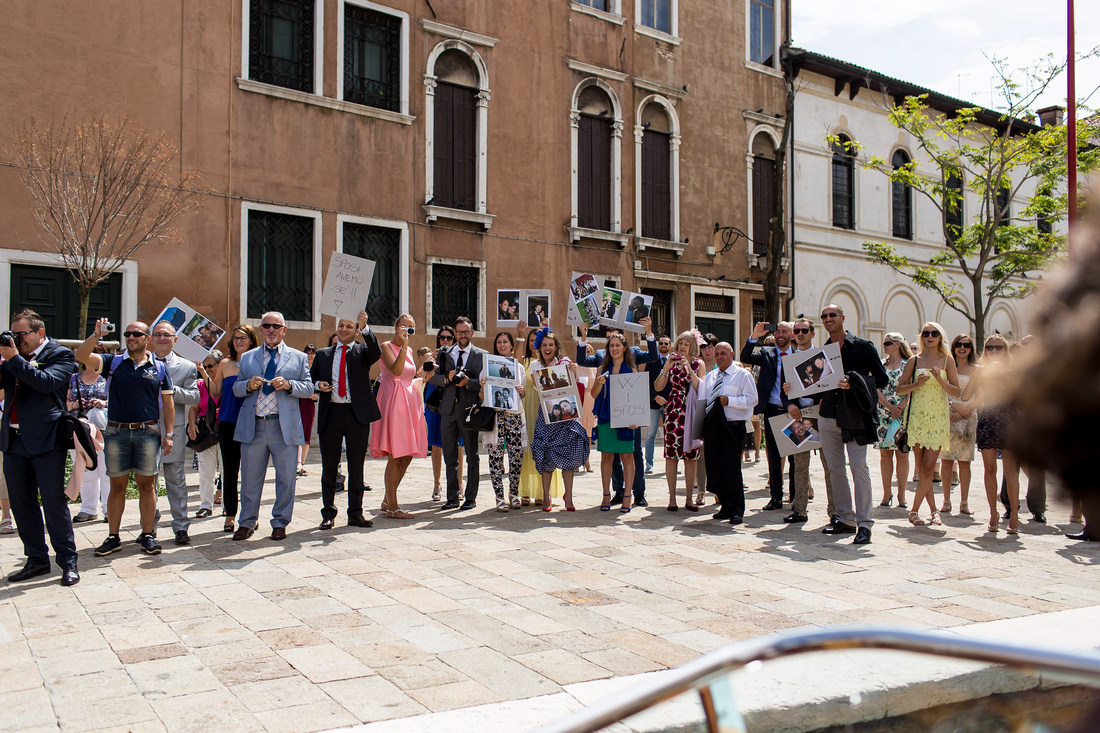 guests waiting for bride during wedding photo service in Venice
