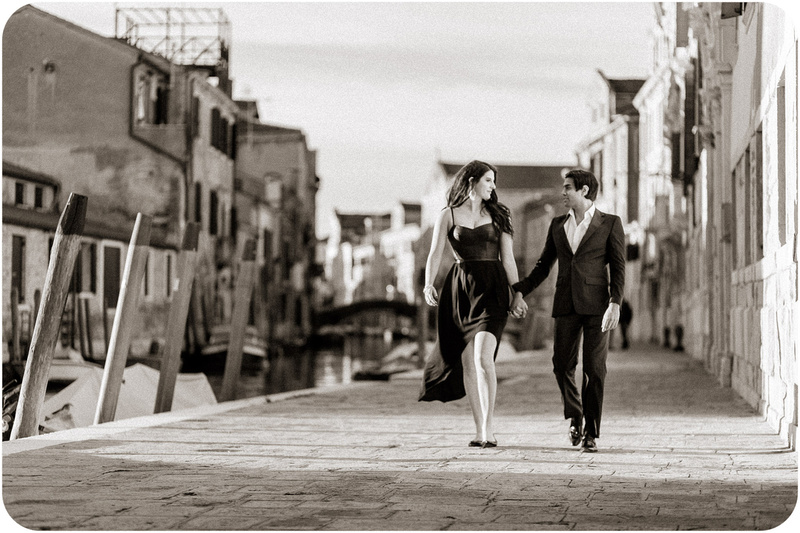 couple walking during engagement photo service in venice