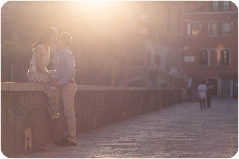 couple kiss for pre-weddding portrait in venice