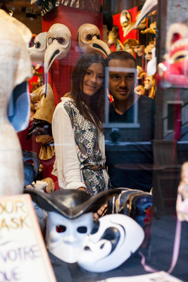 Russian couple visiting a masks shop in Venice during an honeymoon photo shooting
