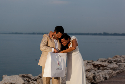 bride enjoying a surprise during a honeymoon photo session