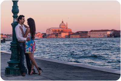 couple hugging during engagement photo session in Venice