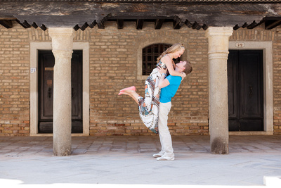 couple hugging under a Venetian porch