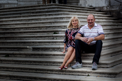 Russian couple sitting on stairs at Punta della Dogana
