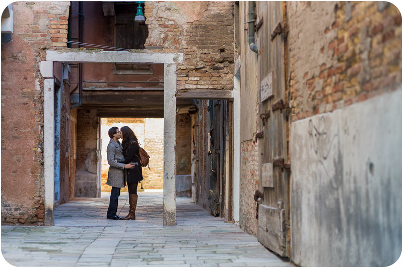 couple kissing during engagement photo session in Venice