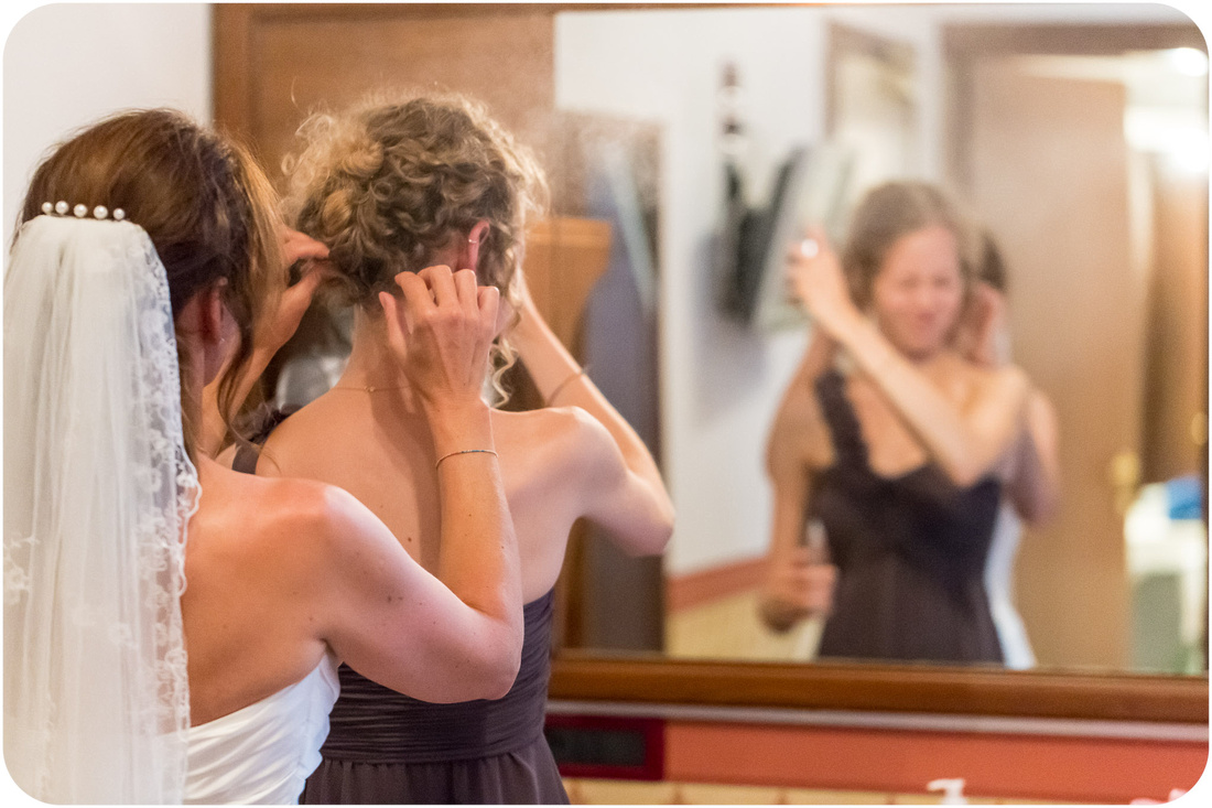 bride and daughter getting ready during wedding photo service in venice