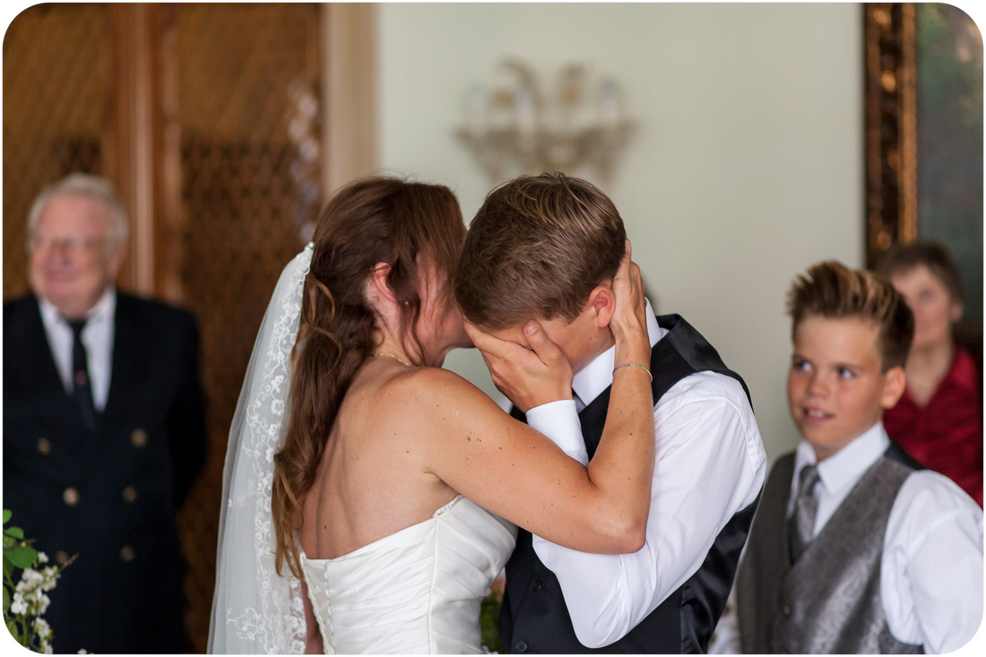bride hugs son after wedding ceremony during wedding photo service in Venice