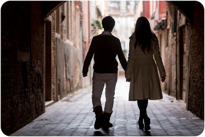 couple walking during informal couple portrait in Venice