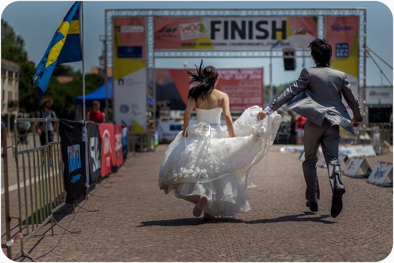asian couple running during pre-wedding photo session