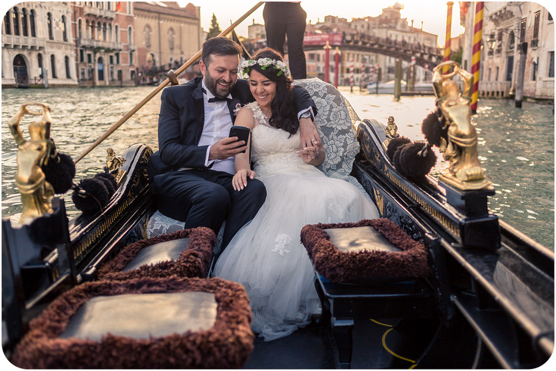couple on gondola during honeymoon portrait session
