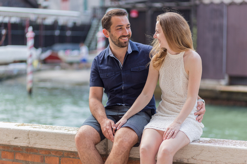 couple sitting during engagement photo session in Venice