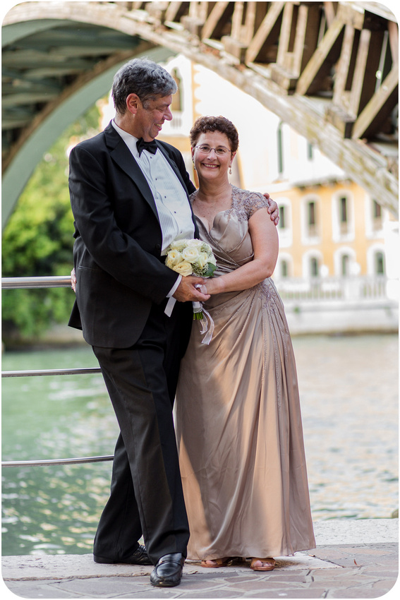 couple hugging during vows renewal photo session in Venice