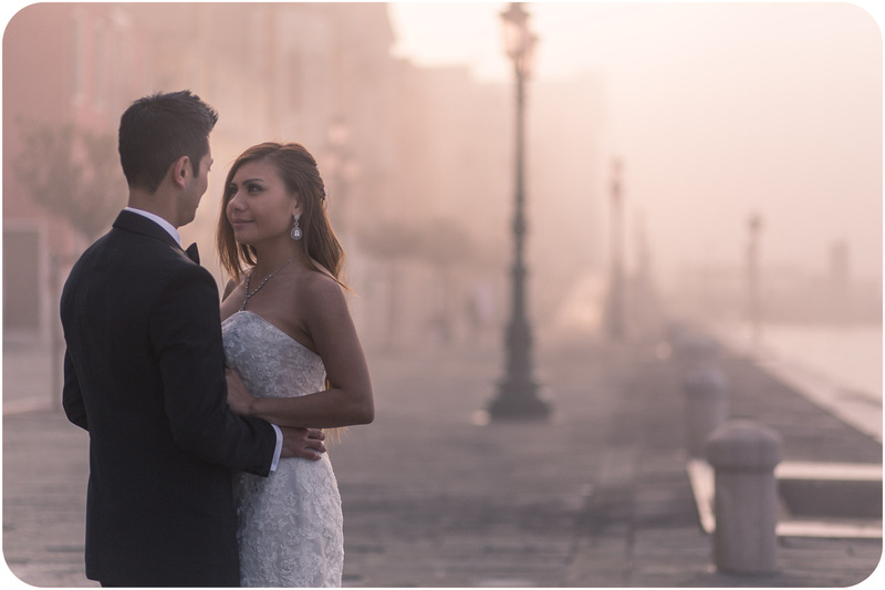 couple hug during pre-wedding photo service in Venice