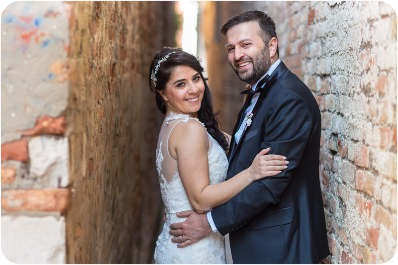 couple hugging during honeymoon photo session in Venice