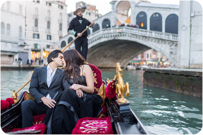 couple kiss on gondola during couple photo session in Venice