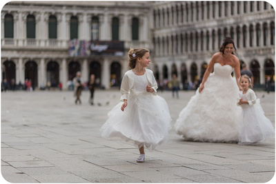 bride with kids during wedding photo service in Venice
