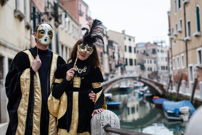 Russian couple enjoying a photo walk in costume in Venice at Carnival