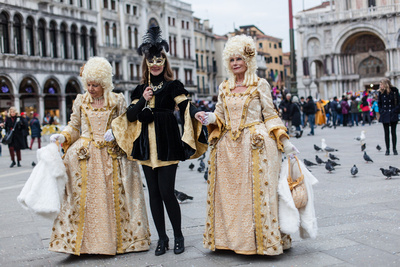 Russian girl poses in San Marco square during informal photo walk in Venice during Carnival