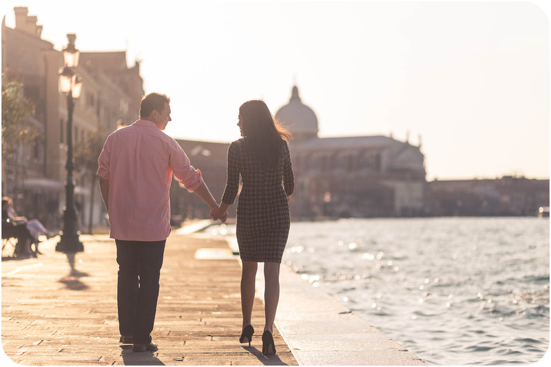 couple walk during engagement photo walk in Venice